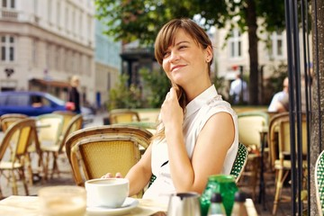 Woman Enjoying the Pleasant Morning with a Cup of Coffee