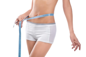 Woman measuring waist of perfect body
