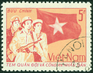 stamp printed in Vietnam showing Vietnam soldier