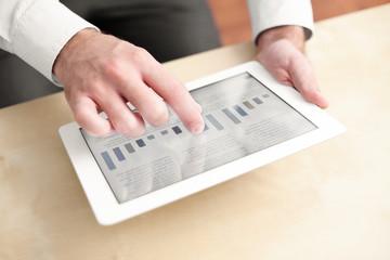 Businessman using digital tablet by the desk