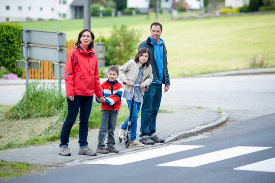 Family will passing the Crosswalk