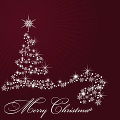 By Christmas tree on claret background