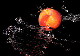 Peach in spray of water