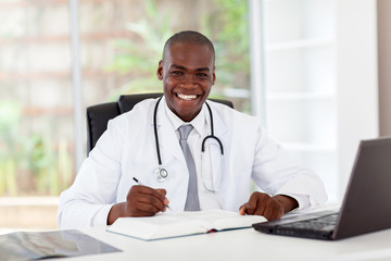 happy african american medical doctor in office