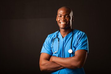 young african american medical doctor portrait over black