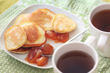 Breakfast for two: tea and pancakes with jam