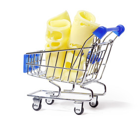 Two appetizing pieces of yellow cheese in shopping cart isolated