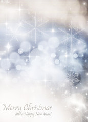 Light bokeh abstract Christmas background with white snowflakes