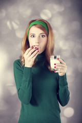 American redhead girl with milk and cake. Photo in 60s style