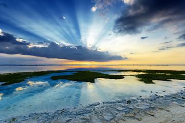 Tropical sunset at low tide. Gili Travangan, Lombok, Indonesia