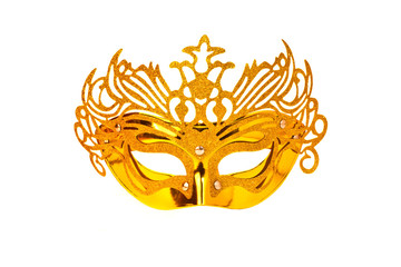 Golden carnival mask on a white background