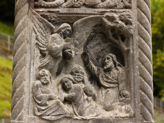 Stone carving image of bible scene in Lourdes, France