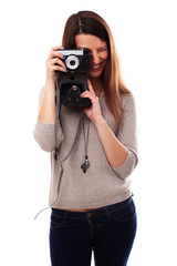Young and pretty girl with photo camera