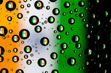 Reflection of India flag in water droplets