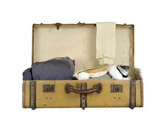 old vintage suitcase ski clothes on white