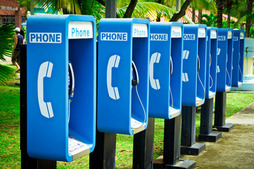 Blue public phone in a row
