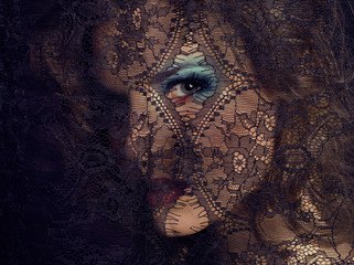 beauty young woman through lace