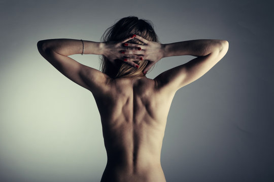 Beautiful nude woman with muscular back