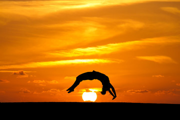 Wall Mural - gymnast in sunset doing a back handspring