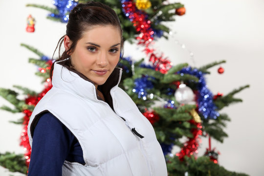 Woman standing in front of a Christmas tree