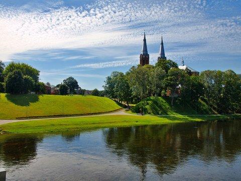 Church in Anyksciai city and beautiful river Sventoji
