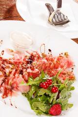 Prosciutto ham with salad