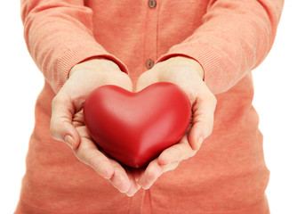 Red heart in woman hands, close up