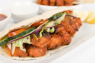 Chicken Tikka Kebab: Tandoori chicken with salad in a pita bread