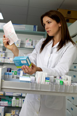 Beautiful woman pharmacist searching medicine with prescription