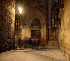 Group of people near cathedral entrance at night