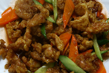 Dry crispy beef in soy sauce and vegetables