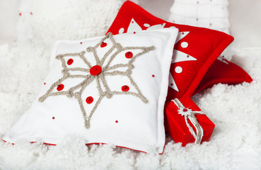 Embroidered snowflake on red and white pillow. Christmas decor