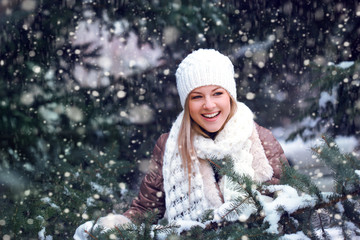 happy woman under snowfall