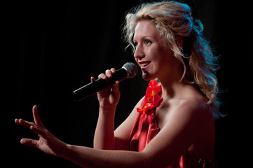 Woman singing in microphone