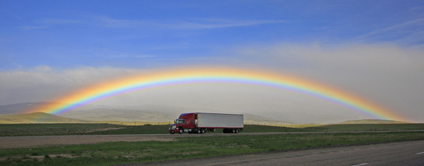 Rainbow over highway with Semi-Truck