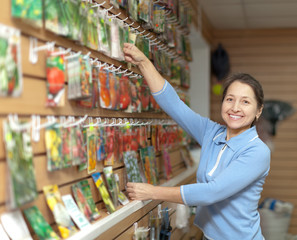 mature woman chooses packed seeds