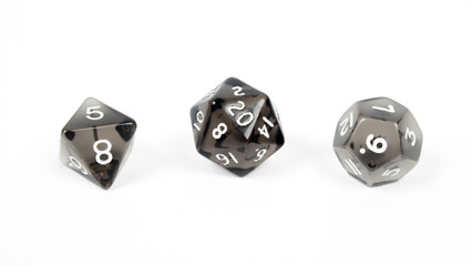 Three black dice isolated on white background
