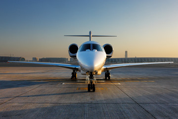 A front on view of a private jet