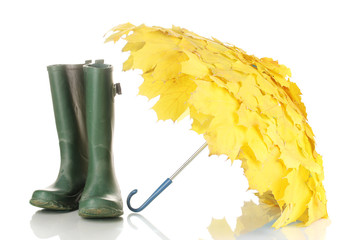 maple leaves umbrella with green gumboots isolated on white