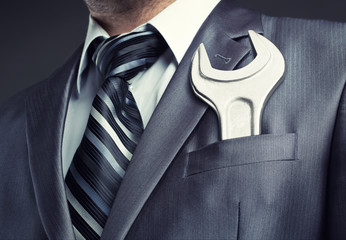 Fotobehang - Businessman with spanner