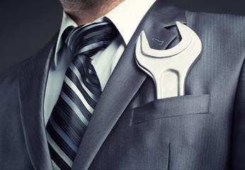 Fotobehang - Businessman with spanner