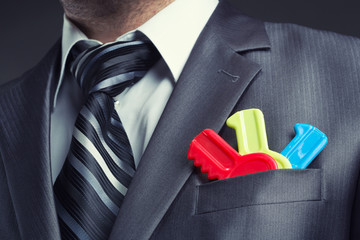 Fotobehang - Businessman with colorful toy keys