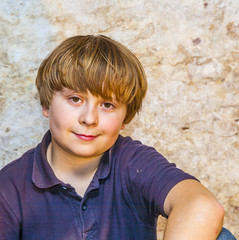 cute young boy with old brick background