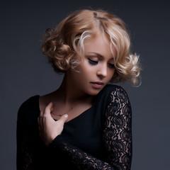Beautiful blond woman with elegant black dress.