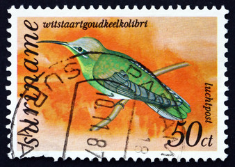 Postage stamp Suriname 1977 White-tailed Goldthroated Hummingbir