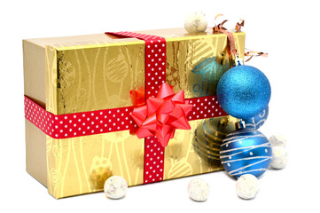 Golden gift box with red ribbon and christmas balls