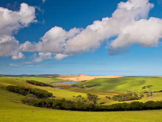 Wall Mural - Green tranquil Valley with Blue Sky
