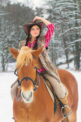 Woman Riding a Horse the Snow