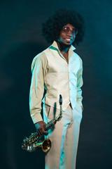 Black american jazz saxophone player. Vintage. Studio shot.