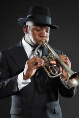 Fotobehang Muziekband Black american jazz trumpet player. Vintage. Studio shot.